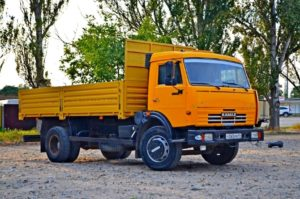 Бортовой КамАЗ 43253, 2015, желтый бу фото