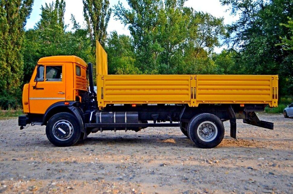 Бортовой КамАЗ 43253, 2015, желтый фото 2