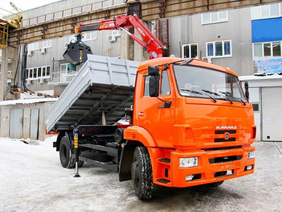 Бортовой КамАЗ 43253 с ГМУ, 2016, оранжевый фото 2