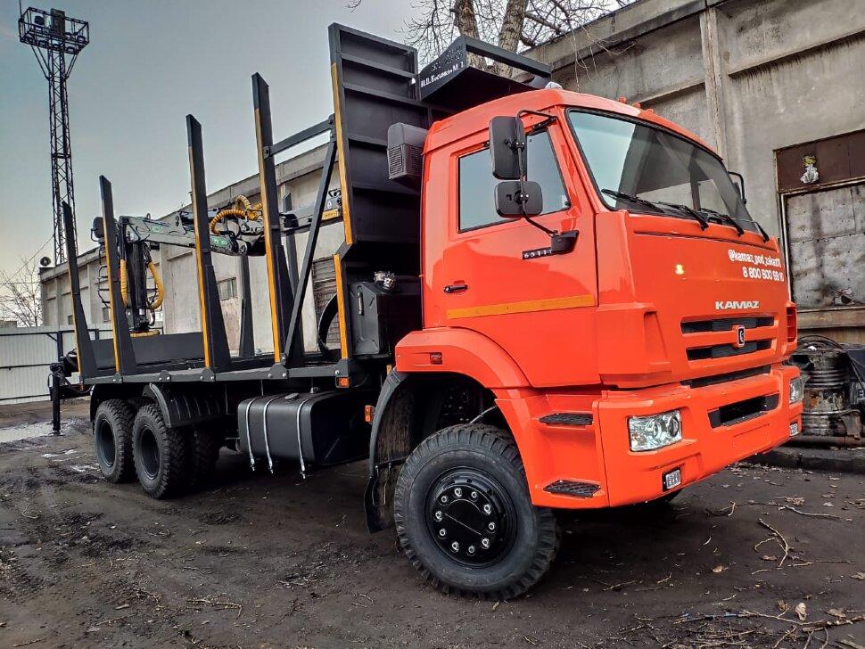 Сортиментовоз КамАЗ 65111 с ГМУ, 2017 г, оранжевый фото 0