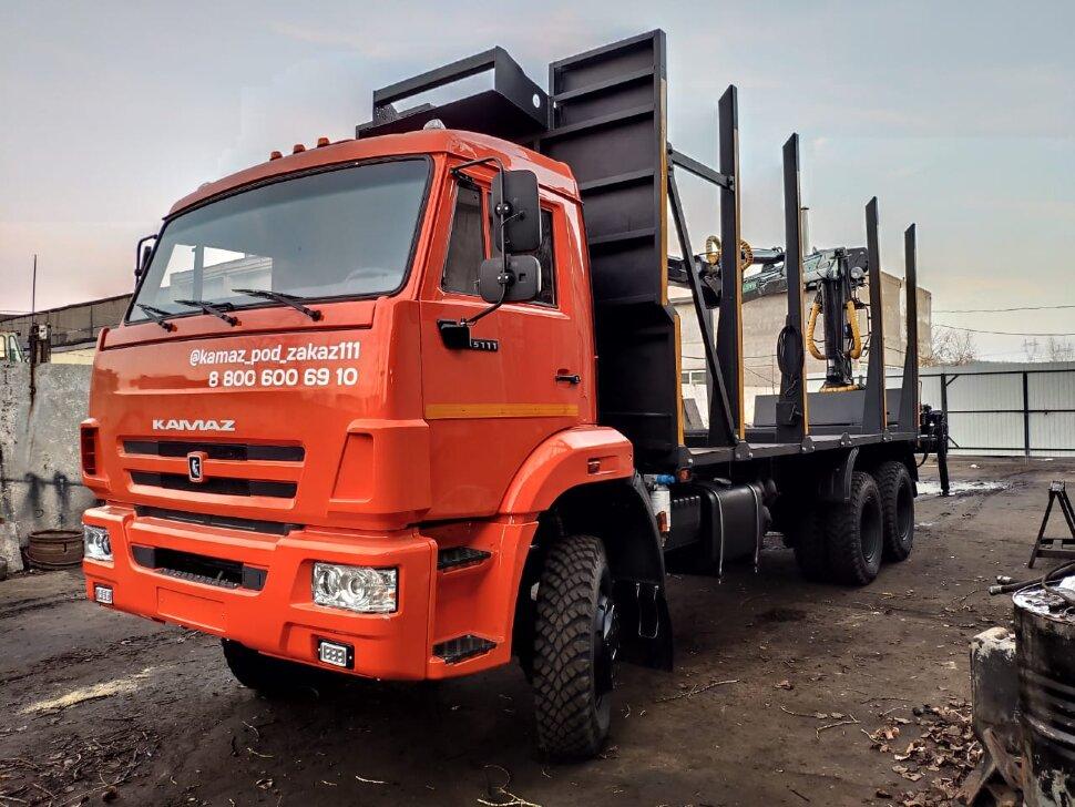 Сортиментовоз КамАЗ 65111 с ГМУ, 2017 г, оранжевый фото 1