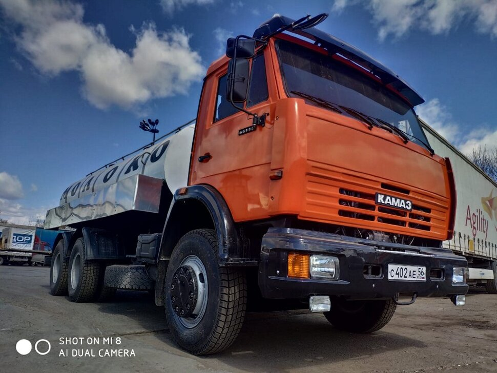 Автоцистерна молоковоз КамАЗ 65115, 2013, оранжевый фото 0