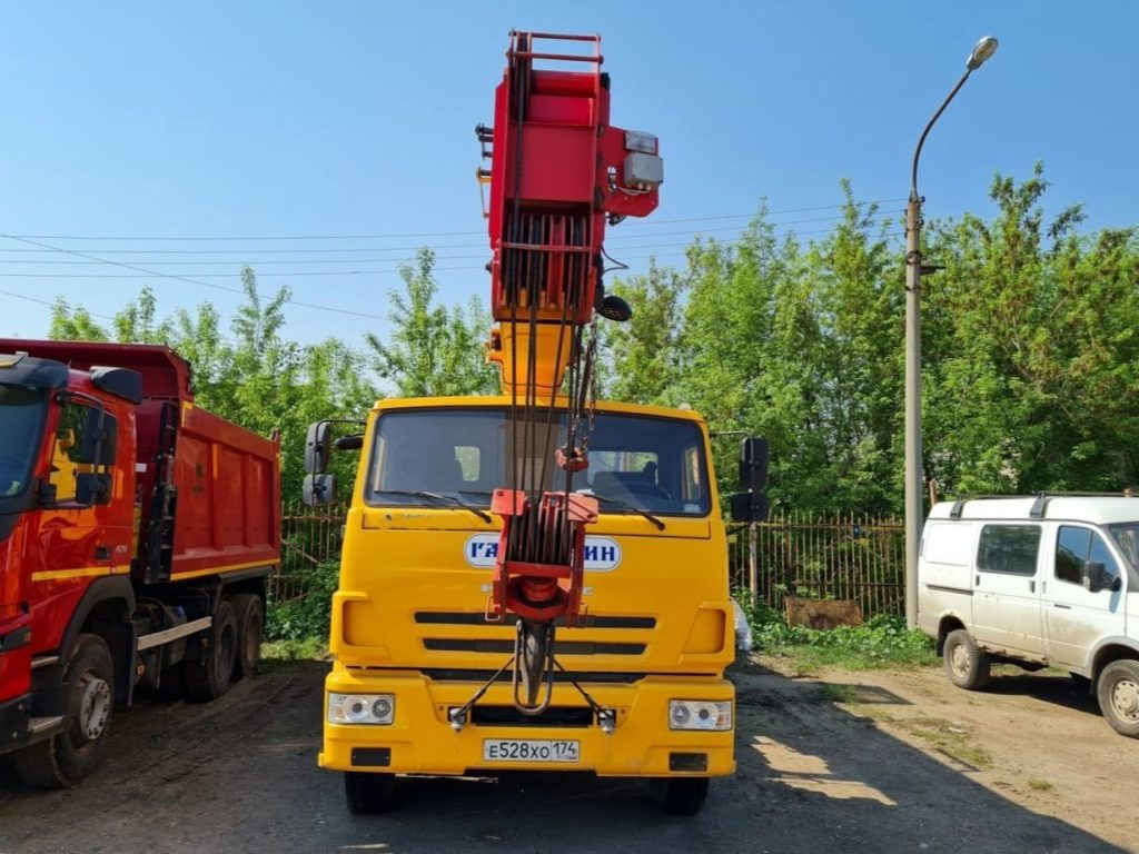 Автокран КамАЗ 65115 Галичанин 25т, 2018, желтый фото 4